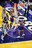 Nate Lubick (center) of the Hoyas grabs the defensive rebound. Georgetown defeated Memphis 70-59 at the Verizon Center in Washington, D.C. on Thursday, December 22, 2011. Alan P. Santos/DC Sports Box