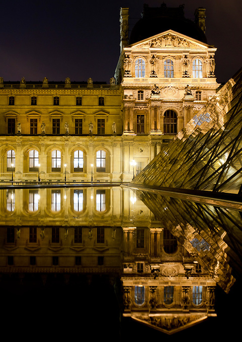 The Louvre Museum is housed in the former Louvre Palace, on the right bank of the Seine, adjoining the Tuileries Gardens in Paris.