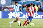 Atletico de Madrid's Angel Correa (r) and Malaga CF's Roberto Rosales during La Liga match. April 23,2016. (ALTERPHOTOS/Acero)