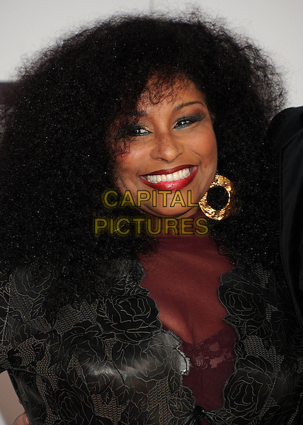 Chaka Khan .2011 American Music Awards - Arrivals held at Nokia Theatre LA Live, Los Angeles, California, USA..November 20th, 2011.ama amas ama's headshot portrait  black suit jacket maroon smiling gold earrings.CAP/ADM/BP.©Byron Purvis/AdMedia/Capital Pictures.