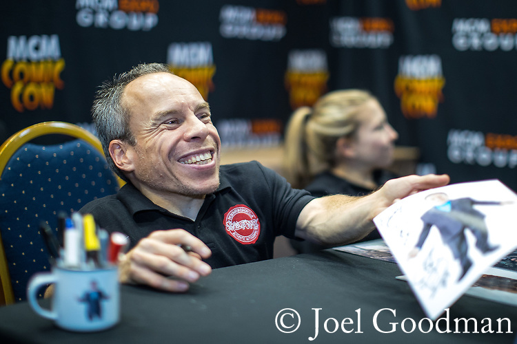 © Joel Goodman - 07973 332324. 30/07/2017 . Manchester , UK . Warwick Davis signing photos for fans . Cosplayers, families and guests at Comic Con at the Manchester Central Convention Centre . Photo credit : Joel Goodman