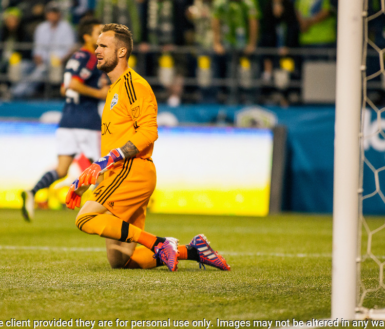 Seattle Sounders goalie Stefan Frei gets off after knocking the ball out of bounds against the New England Revolution during an MLS match on March 8, 2015 in Seattle, Washington.  The Sounders beat the Revolution 3-0.  Jim Bryant Photo. ©2015. All Rights Reserved.