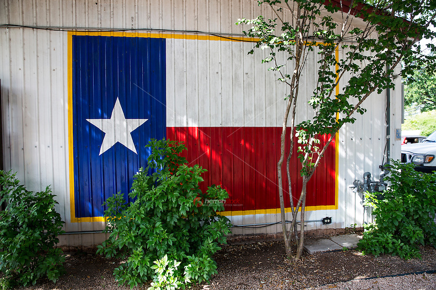 Texans are in love with the lone star flag, the simplicity of the design that makes the flag so distinctive. Texans take pride in their red and white flag with that blue Lone Star - Stock Image.