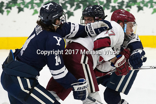 Mitchell Smith (Yale - 14), Sean Malone (Harvard - 17), Adam Larkin (Yale - 2) - The Harvard University Crimson tied the visiting Yale University Bulldogs 1-1 on Saturday, January 21, 2017, at the Bright-Landry Hockey Center in Boston, Massachusetts.
