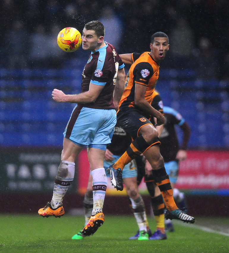 Burnley's Sam Vokes vies for possession with Hull City's Isaac Hayden<br /> <br /> Photographer Chris Vaughan/CameraSport<br /> <br /> Football - The Football League Sky Bet Championship - Burnley v Hull City - Saturday 6th February 2016 - Turf Moor - Burnley <br /> <br /> &copy; CameraSport - 43 Linden Ave. Countesthorpe. Leicester. England. LE8 5PG - Tel: +44 (0) 116 277 4147 - admin@camerasport.com - www.camerasport.com