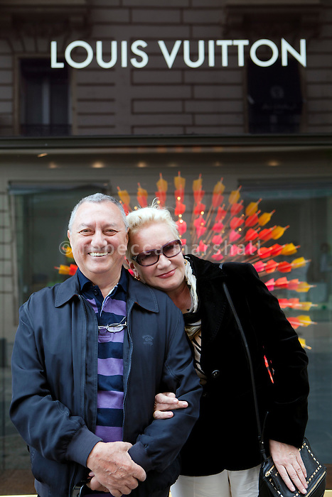 Russian tourists pose for the photographer in front of the Louis Vitton store, Avenue de Verdun, Nice, France, 28 April 2012