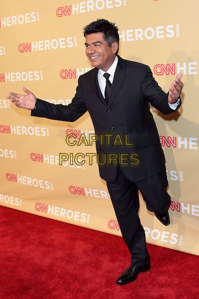 GEORGE LOPEZ.CNN Heroes: An All Star Tribute 2009  held at Kodak Theatre, Hollywood, California, USA..November 21st 2009 .full length black suit hands arms legs up outstretched  .CAP/ADM/TC.©T. Conrad/AdMedia/Capital Pictures.