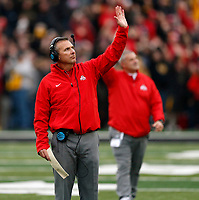 Ohio State Buckeyes head coach Urban Meyer wave to children and families in the UI Stead Family Children's Hospital at the end of the 1st quarter at Kinnick Stadium in Iowa City on November 4, 2017.  [Kyle Robertson\Dispatch]