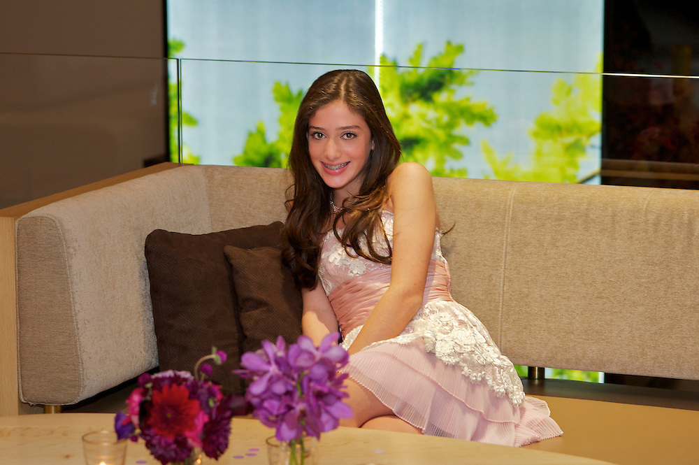 Seated portrait of the Bat Mitzvah girl at her party.
