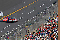 Apr 29, 2007; Talladega, AL, USA; Fans throw bottles and cans as Nascar Nextel Cup Series driver Dale Earnhardt Jr (8) drives alongside Jeff Gordon (24) after winning the Aarons 499 under caution at Talladega Superspeedway. Mandatory Credit: Mark J. Rebilas