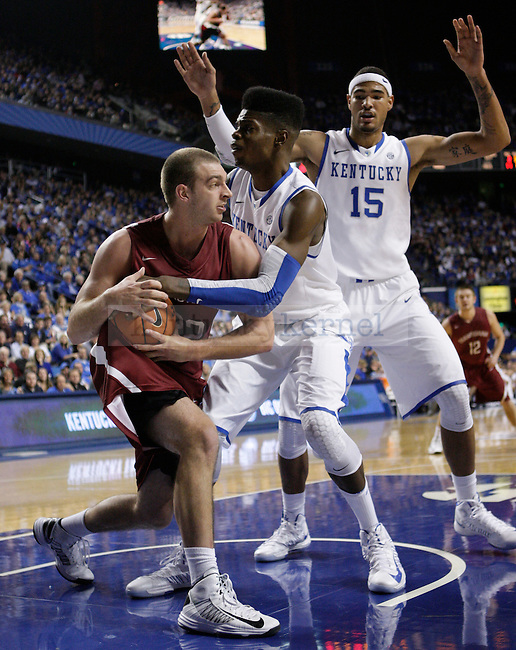 UK forward Nerlens Noel (3) and forward Willie Cauley-Stein (15) guard Transy forward Ethan Spurlin (22) during the second half of the UK men's basketball game vs. Transylvania University at Rupp Arena in Lexington, Ky., on Monday, November 5, 2012. Photo by Tessa Lighty   Staff