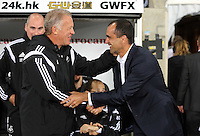 Pictured L-R: Alan Curtis of Swansea greets former Swansea player Roberto Martinez manager for Everton. Tuesday 23 September 2014<br /> Re: Capital One Cup, Swansea City FC v Everton at the Liberty Stadium, south Wales, UK