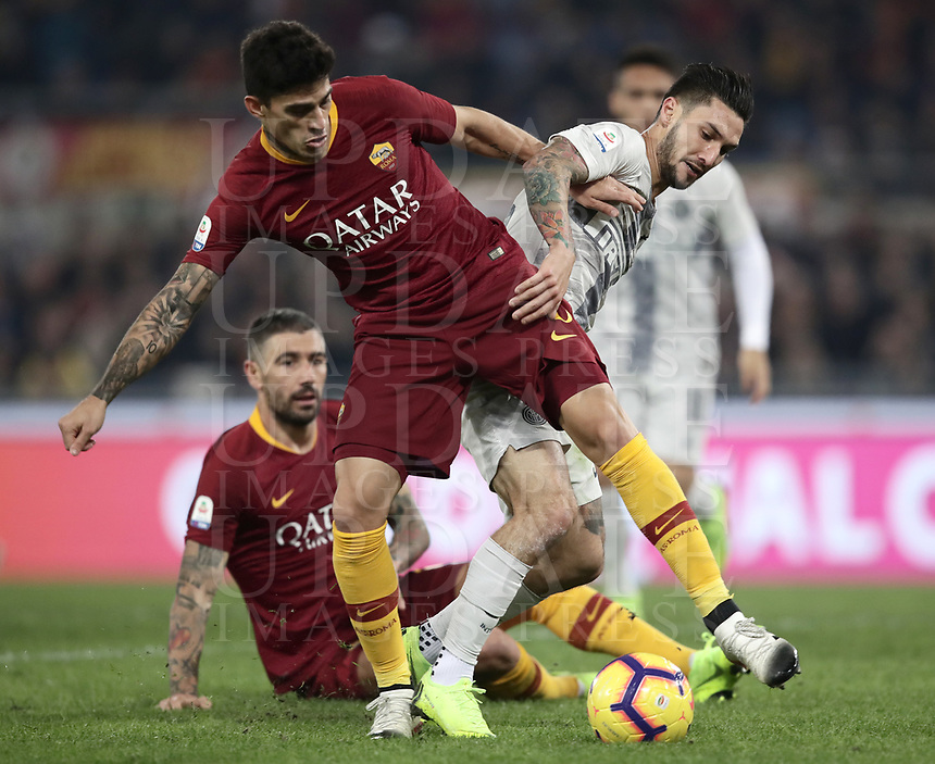 Football, Serie A: AS Roma - InterMilan, Olympic stadium, Rome, December 02, 2018. <br /> Inter's Matteo Politano (r) in action with Roma's Diego Perotti (l) during the Italian Serie A football match between Roma and Inter at Rome's Olympic stadium, on December 02, 2018.<br /> UPDATE IMAGES PRESS/Isabella Bonotto
