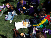 Northwestern freshmen eat lunch while sitting in the grass at Wildcat Alley before the game between South Dakota and Northwestern.