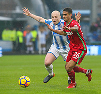 Huddersfield Town's Aaron Mooy battles with Swansea City's Kyle Naughton<br /> <br /> Photographer Alex Dodd/CameraSport<br /> <br /> The Premier League - Huddersfield Town v Swansea City - Saturday 10th March 2018 - John Smith's Stadium - Huddersfield<br /> <br /> World Copyright &copy; 2018 CameraSport. All rights reserved. 43 Linden Ave. Countesthorpe. Leicester. England. LE8 5PG - Tel: +44 (0) 116 277 4147 - admin@camerasport.com - www.camerasport.com