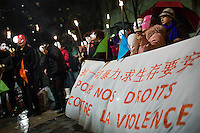 Women of Chinese descent concealed by masks, representing  sex workers in Paris, take part in a demonstration on the International Day to End Violence Against Sex Workers at Place Jean Rostand. Chinese sex workers in Paris, who are usually here without legal papers, often experience violence and harassment on the streets from clients and even police. Paris, France. Dec. 17, 2014