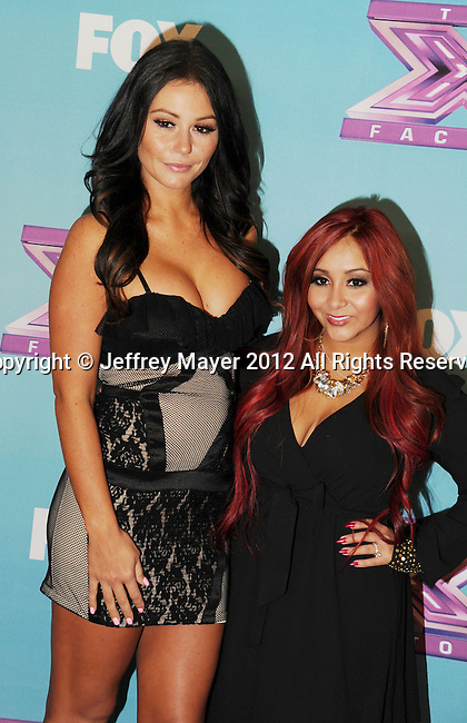 LOS ANGELES, CA - DECEMBER 19: Jenni 'Jwoww' Farley and Nicole 'Snooki' Polizzi arrive at Fox's 'The X Factor' Season Finale Night 1 at CBS Televison City on December 19, 2012 in Los Angeles, California.
