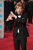 London, UK. 14 February 2016. Actor Domnhall Gleeson. Red carpet arrivals for the 69th EE British Academy Film Awards, BAFTAs, at the Royal Opera House. © Vibrant Pictures/Alamy Live News