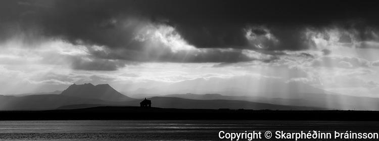 Sunrays in south Iceland, mountain Þríhyrningur and Glacier Eyjafjallajökull in the distance