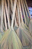 Hmong hand made straw or fiber brooms at concession stand. Hmong Sports Festival McMurray Field St Paul Minnesota USA