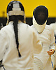 Jung Soo Ahn of Commack, right, duels against Delmy Santos of Brentwood in epee during a girls fencing match at Commack High School on Friday, Dec. 2, 2016. Ahn won the bout 5-2.