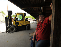 NWA Democrat-Gazette/ANDY SHUPE<br /> Lloyd Center, yard foremen at City Lumber in Fayetteville, speaks Friday, May 26, 2017, while waiting to load lumber for customers at the longtime business in south Fayetteville. Center has worked at lumber yards since the mid-1970s.
