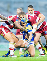 Picture by Allan McKenzie/SWpix.com - 13/04/2018 - Rugby League - Betfred Super League - Leeds Rhinos v Wigan Warriors - Headingley Carnegie Stadium, Leeds, England - Ashton Golding is tackeld by Tony Clubb.