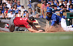 Los Angeles Dodgers' Scott Van Slyke scores as Arizona Diamondbacks' Kevin Jepsen dives for the throw during a spring training game in Glendale, Ariz., on Friday, March 24, 2017.<br /> Photo by Cathleen Allison/Nevada Photo Source