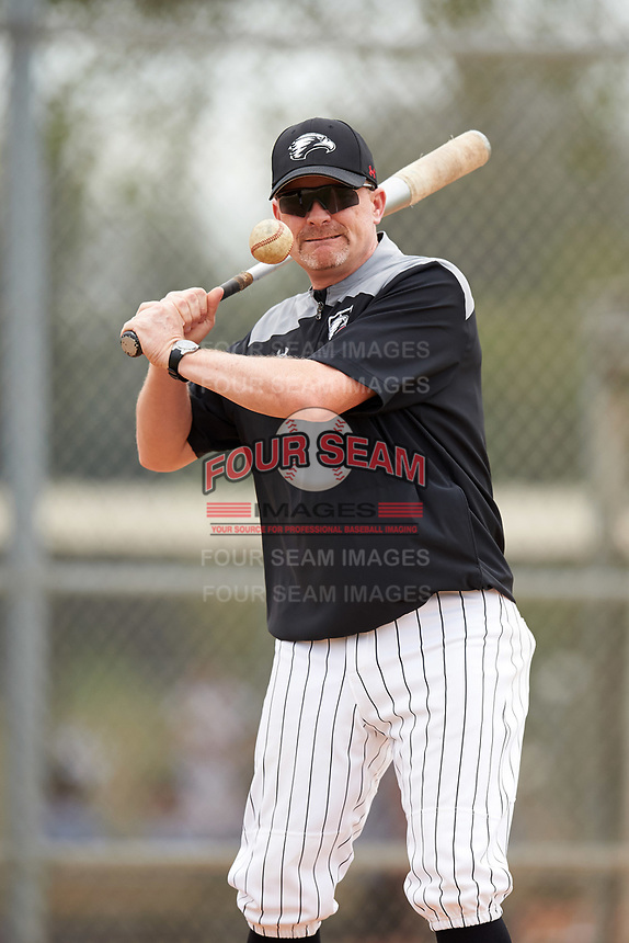 Edgewood College Eagles head coach Al Brisack hits ground balls during practice before the first game of a doubleheader against Western Connecticut Colonials on March 13, 2017 at the Lee County Player Development Complex in Fort Myers, Florida.  Edgewood defeated Western Connecticut 3-0.  (Mike Janes/Four Seam Images)