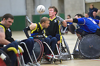 27 MAY 2013 - DONCASTER, GBR - Luke White (second from the right) of Stoke Mandeville Storm reaches for the ball during the 2013 Great Britain Wheelchair Rugby Nationals final against Kent Crusaders at The Dome in Doncaster, South Yorkshire .(PHOTO (C) 2013 NIGEL FARROW)
