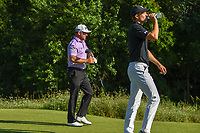 Jordan Spieth (USA) rehydrates as he and Graeme McDowell (NIR) head down 13 during round 2 of the AT&amp;T Byron Nelson, Trinity Forest Golf Club, at Dallas, Texas, USA. 5/18/2018.<br /> Picture: Golffile | Ken Murray<br /> <br /> <br /> All photo usage must carry mandatory copyright credit (&copy; Golffile | Ken Murray)