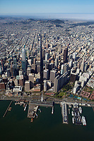 high aerial photograph of the San Francisco financial district, waterfront and Ferry Building at the Embarcadero down Market Street toward the Pacific Ocean, San Francisco, California