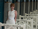 Jessica Chastain poses in front of her dedicated beach locker room on the Promenade des Planches on September 5, 2014 in Deauville, France