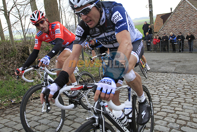 Saxo Bank team rider Fabian Cancellara turns the 90 degree corner to face up the steep Paterberg during the grueling Tour of Flanders, 4th April 2010 (Photo by Eoin Clarke/NEWSFILE).