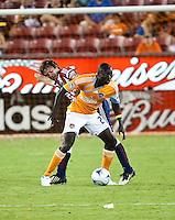 Houston Dynamo forwarad Dominic Oduro (23) shields the ball from Chivas USA defender Carey Talley (12).  Houston Dynamo defeated CD Chivas USA 1-0 at Robertson Stadium in Houston, TX on June 10, 2009.
