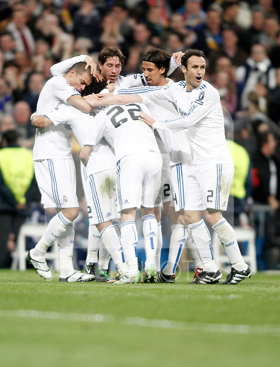 Real Madrid's players celebrate during Champions League match. March 16, 2011. (ALTERPHOTOS/Alvaro Hernandez)