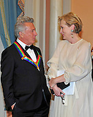 Dustin Hoffman, one of the seven recipients of the 2012 Kennedy Center Honors, shares some thoughts with Meryl Streep, one of the 2011 recipients as he waits to pose for a photo following a dinner hosted by United States Secretary of State Hillary Rodham Clinton at the U.S. Department of State in Washington, D.C. on Saturday, December 1, 2012.  The 2012 honorees are Buddy Guy, actor Dustin Hoffman, late-night host David Letterman, dancer Natalia Makarova, and the British rock band Led Zeppelin (Robert Plant, Jimmy Page, and John Paul Jones)..Credit: Ron Sachs / CNP
