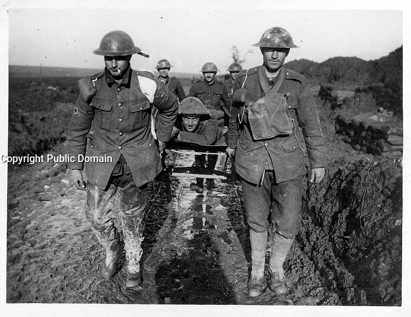 With the Canadians on the western front<br /> Description<br /> <br /> Bringing in a wounded Canadian through the mud