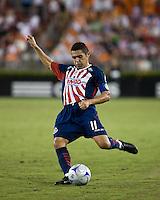 CD Guadalajara midfielder Ramon Morales (11) strikes the ball.  CD Guadalajara defeated Houston Dynamo 1-0 during the group stage of the Superliga 2008 tournament at Robertson Stadium in Houston, TX on July 15, 2008.