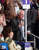 United States Senator Bernie Sanders (Democrat of Vermont) moves that the rules of the convention be suspended and Hillary Clinton be nominated by acclamation during the second session of the 2016 Democratic National Convention at the Wells Fargo Center in Philadelphia, Pennsylvania on Tuesday, July 26, 2016.  His wife Jane Sanders looks on from left.<br /> Credit: Ron Sachs / CNP<br /> (RESTRICTION: NO New York or New Jersey Newspapers or newspapers within a 75 mile radius of New York City)