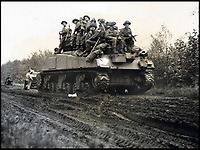 BNPS.co.uk (01202 558833)<br /> Pic:  ChiswickAuctions/BNPS<br /> <br /> Allies entering Germany on a tank.<br /> <br /> Remarkable previously unseen photos documenting the momentous closing stages of World War Two and its historic aftermath have come to light.<br /> <br /> They were taken by Sergeant Charles Hewitt, of the Army Film and Photographic Unit, who later went on to work for the Picture Post and the BBC.<br /> <br /> He was present at many of the important offensives of 1944 and '45 including the Battle of Monte Cassino during the Italian Campaign and the Allies advance into Germany following the D-Day invasion.