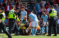 Sergio Aguero of Manchester City & a steward appear to have an altercation after a Man City supporter is detained on the ground during the Premier League match between Bournemouth and Manchester City at the Goldsands Stadium, Bournemouth, England on 26 August 2017. Photo by Andy Rowland.