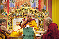 "Switzerland. Basel. St. Jakobshalle. His Holiness the Dalai Lama is blessing a woman before his public lecture on Bodhicitta. The topic of his talk is about Nagarjuna's Commentary on Bodhicitta which touches on two aspects of the awakening mind, the twin qualities of wisdom and compassion, which are necessary for anyone who aspires to be a better person and implement changes in their lives. The 14th and current Dalai Lama is Tenzin Gyatso, recognized since 1950. He is the current Dalai Lama, as well as the longest-lived incumbent, well known for his lifelong advocacy for Tibetans inside and outside Tibet. Dalai Lamas are amongst the head monks of the Gelug school, the newest of the schools of Tibetan Buddhism. The Dalai Lama, also called "" Ocean of Wisdom"" is considered as the incarnation of Chenresi, the Bodhisattva of compassion who is also the protective deity of Tibet. 7.02.2015 © 2015 Didier Ruef"
