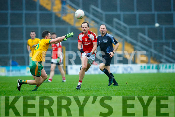 Donal O'Sullivan Rathmore gets his pass away from Padraig O'Connor Gneeveguilla