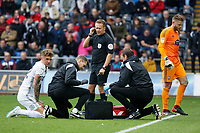 Joe Rodon of Swansea City (L) sits on the ground injured next to Physiotherapist, Ritson Lloyd, referee Oliver Langford, Dr. Jez McCluskey, Club Doctor and Dean Gerken of Ipswich Town during the Sky Bet Championship match between Swansea City and Ipswich Town at the Liberty Stadium, Swansea, Wales, UK. Saturday 06 October 2018