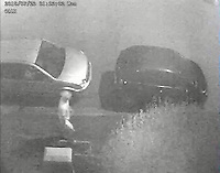 """Pictured: CCTV image released by South Wales Police showing four persons are observed walking along pavement past a Silver Ford Fusion in which Malaciah Thomas is sat.<br /> 1st Male Dan Roberts followed by 2nd Male Christopher Griffiths, he is followed shortly by a third Male Saif Shazhad, (Thomas is seen getting out of the car as Shazhad passes) the 4th Male is Awez Jamshaid.<br /> Re: Earlier this week Christopher Griffiths and Awez Jamshaid were convicted of murdering Malaciah Thomas and Saif Shahzad was found guilty of manslaughter.<br /> A fourth man, Daniel Roberts, admitted murder partway through the trial.<br /> Today, all four were sentenced at Cardiff Crown Court:<br /> Daniel Roberts, Christopher Griffiths, and Awez Jamshaid, were all sentenced to life imprisonment.<br /> Roberts, 20, and Griffiths, 30, must serve a minimum of 25 years, while 19-year-old Jamshaid will serve at least 11 years.<br /> Shahzad, 19, was sentenced to 7 years 6 months in a Young Offenders Institution.<br /> Just before 2am on Monday, July 23 2018, officers were called to reports of a serious assault in the front garden of a house in Corporation Road, Grangetown.<br /> Malaciah Thomas 20, suffered multiple stab wounds and died at the scene.<br /> Speaking after the sentencing at Cardiff Crown Court, Senior Investigating Officer Detective Chief Inspector Gareth Morgan said: """"Malaciah Thomas was stabbed to death just two days before his 21st birthday and our thoughts are with his family and friends.<br />  """"This tragic case sadly highlights the devastating and far-reaching consequences of knife crime.<br />  """"Knife crime has risen across the UK and unfortunately we are not an exception to that.<br />  """"During the early hours of Monday, July 23rd 2018 four young men left an address in Roath and drove to Grangetown.<br />  """"Two of them were armed with knives - all four knew the objective was to attack Malaciah.<br />  """"Following a thorough investigation and trial at Cardiff Crown Co"""