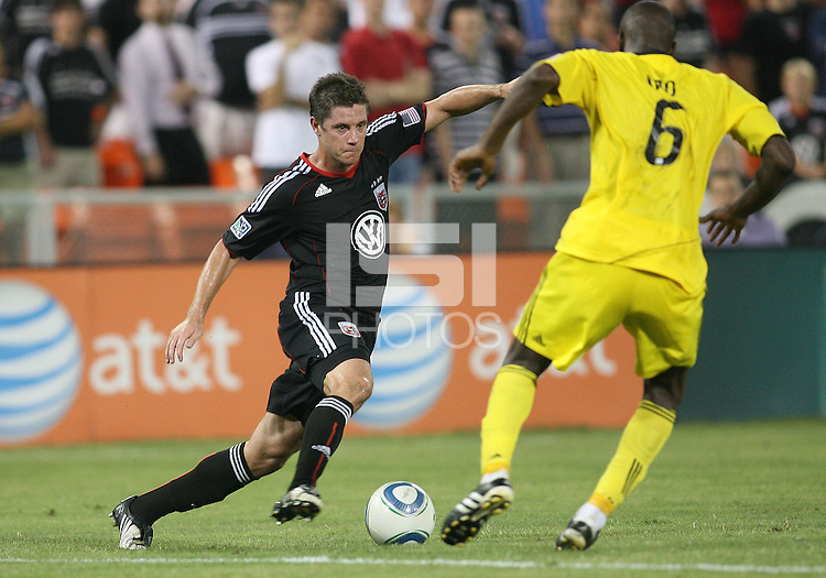 Devon McTavish #18 of D.C. United moves towards Andy Iro #6 of the Columbus Crew during a US Open Cup semi final match at RFK Stadium on September 1 2010, in Washington DC. Columbus won 2-1 aet.