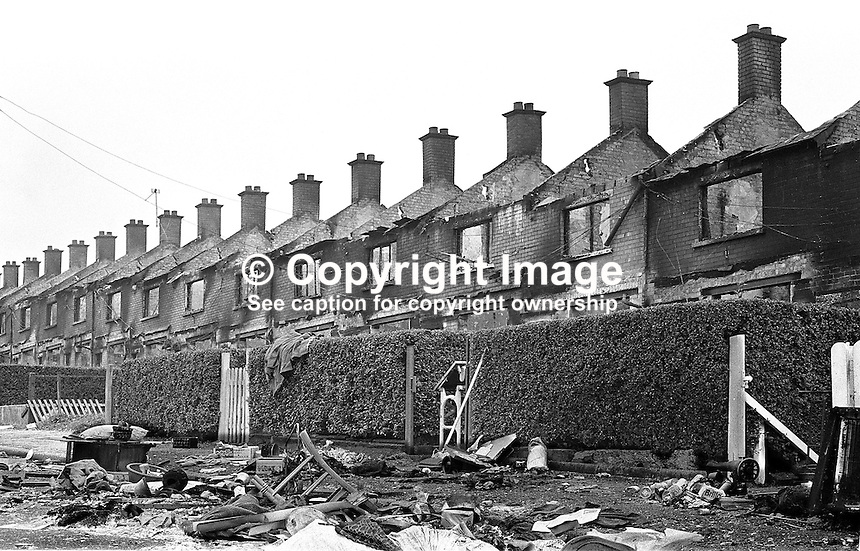 Burn-out homes in Farringdon Gardens, Belfast, N Ireland, UK, with the road littered with debris as evidence of a speed evacuation. The Protestant occupants felt under threat following post-internment rioting in the area. They deliberately torched the houses to prevent them being taken over by Roman Catholics. 380/71, 197108090380b..Copyright Image from Victor Patterson, 54 Dorchester Park, Belfast, UK, BT9 6RJ..Tel: +44 28 9066 1296.Mob: +44 7802 353836.Voicemail +44 20 8816 7153.Skype: victorpattersonbelfast.Email: victorpatterson@mac.com.Email: victorpatterson@ireland.com (back-up)..IMPORTANT: If you wish to use this image or any other of my images please go to www.victorpatterson.com and click on the Terms & Conditions. Then contact me by email or phone with the reference number(s) of the image(s) concerned.