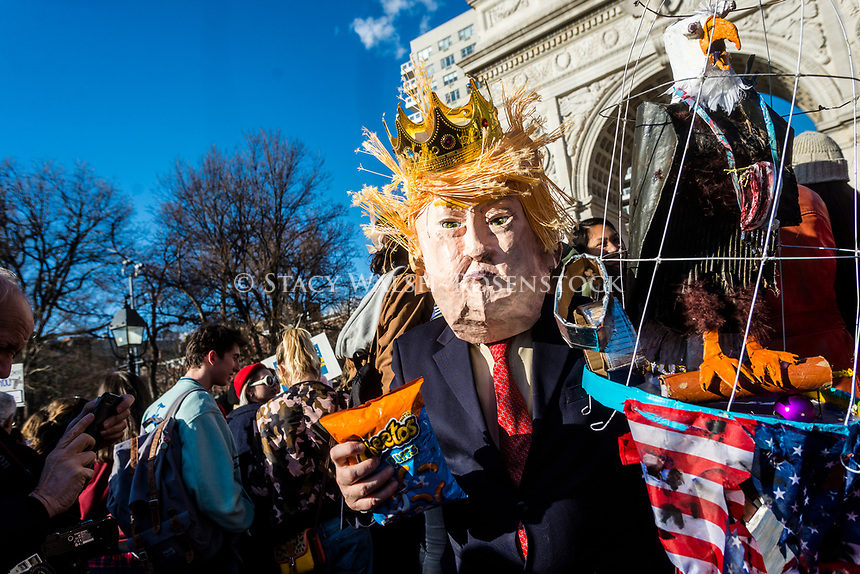 New York, USA 8 March 2017 - Women marked International Women's Day - A Day Without a Woman, with a rally in Washington Square Park followed by a march. Many women wore red and took the day off as a general strike. A mock Donald Trump with a caged American Eagle and a bag of cheetos in front of Washington Arch ©Stacy Walsh Rosenstock/Alamy Live News