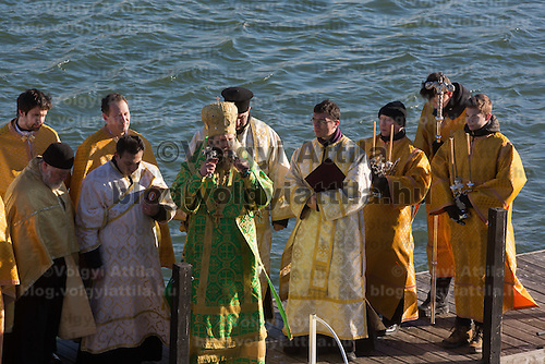 Greek catholic priest sanctifies the water of river Danube on the occasion of Epiphany in central Budapest, Hungary on January 06, 2017. ATTILA VOLGYI